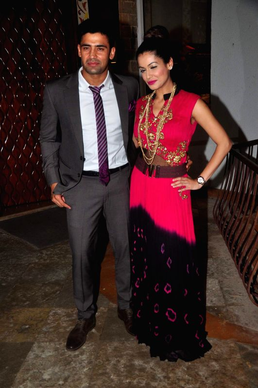 Wrestler Sangram Singh along with his wife Payal Rohatgi during the music launch of film Uvaa in Mumbai, on June 5, 2015. - Sangram Singh