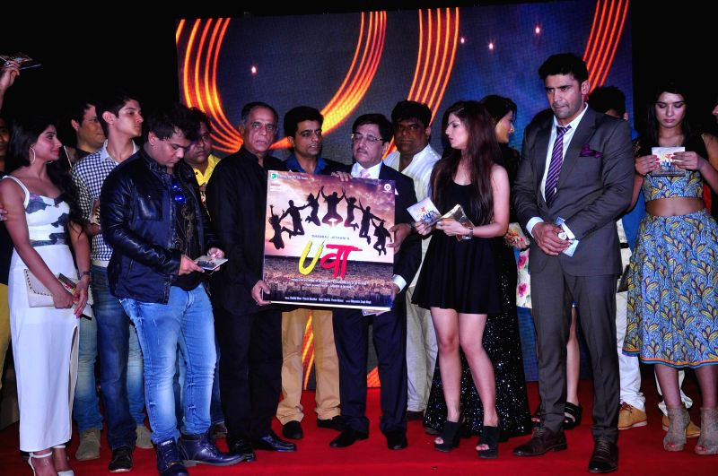 Wrestler Sangram Singh and others star cast of the music launch of film Uvaa in Mumbai, on June 5, 2015. - Sangram Singh