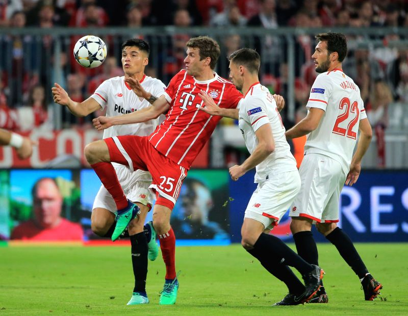 MUNICH, April 12, 2018 - Bayern Munich's Thomas Mueller (2nd L) vies with Sevilla's Joaquin Correa (1st L), Clement Lenglet (2nd R) and Franco Vazquez during the UEFA Champions League quarterfinal ...