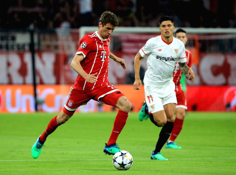 MUNICH, April 12, 2018    Bayern Munich's Thomas Mueller (L) competes during the UEFA Champions League quarterfinal second leg soccer match between Bayern Munich of Germany and FC Sevilla of ...
