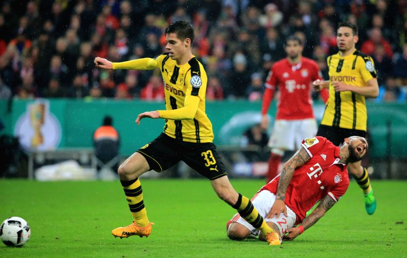 MUNICH, April 27, 2017 - Bayern Munich's Arturo Vidal (front R) falls down after vying with Borussia Dortmund's Julian Weigl (front L) during a semifinal match of German Cup between Bayern Munich and ...