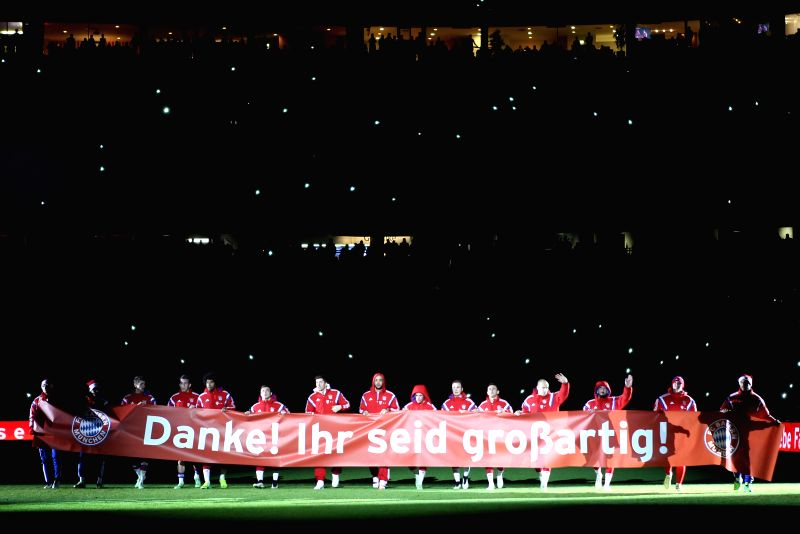 "Bayern Munich's players greet the spectators with a banner which says "" Thank you! You are wonderfull"" after the German first division Bundesliga football ."