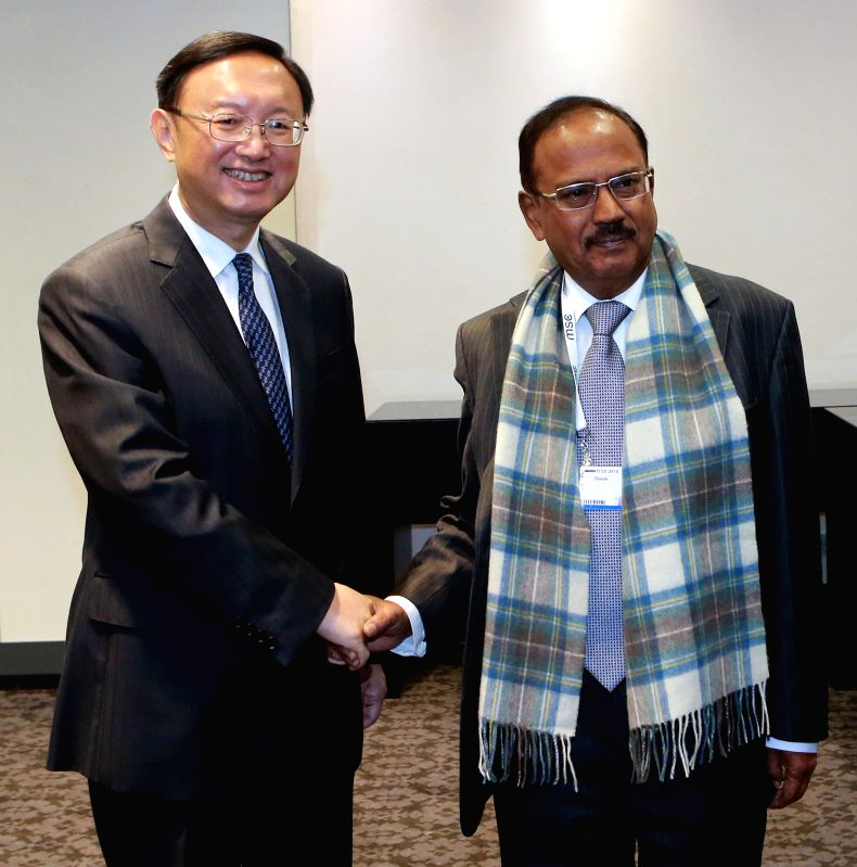 Chinese State Councilor Yang Jiechi (L) meets with Indian National Security Advisor Ajit Kumar Doval on the sidelines of the ongoing 51th Munich Security ...