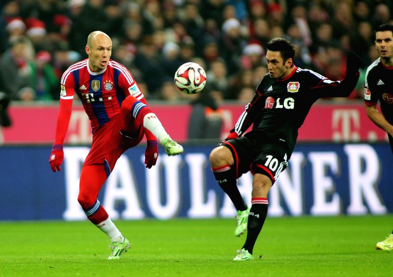 Munich (Germany): Bayern Munich's Arjen Robben (L) vies for the ball during the German first division Bundesliga football match between Bayern Munich and Leverkusen in Munich, Germany, on Dec. 6, ...