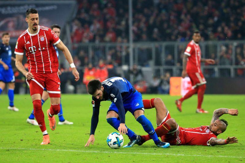 MUNICH, Jan. 28, 2018 - Bayern Munich's Arturo Vidal (R) vies with Hoffenheim's Florian Grillitsch (C) during the German Bundesliga match between Bayern Munich and TSG 1899 Hoffenheim, in Munich, ...