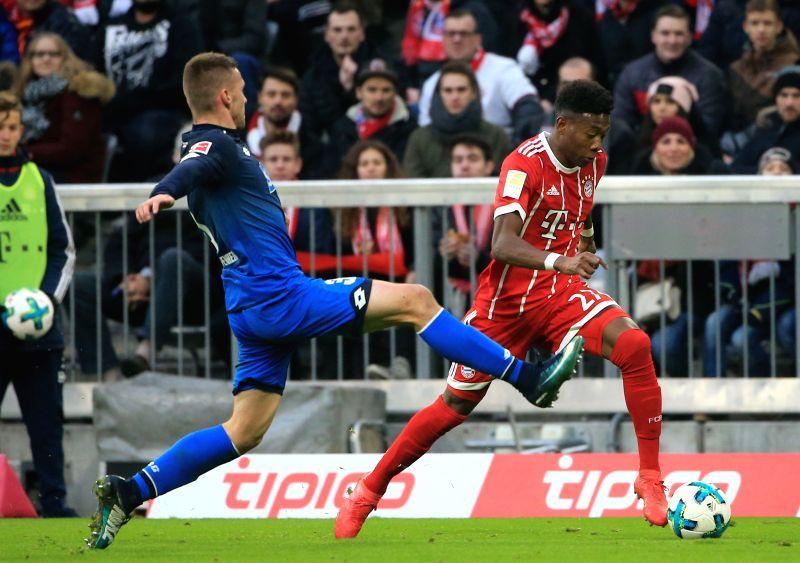 MUNICH, Jan. 28, 2018 - Bayern Munich's David Alaba (R) breaks through the defense from Hoffenheim's Pavel Kaderabek during the German Bundesliga match between Bayern Munich and TSG 1899 Hoffenheim, ...