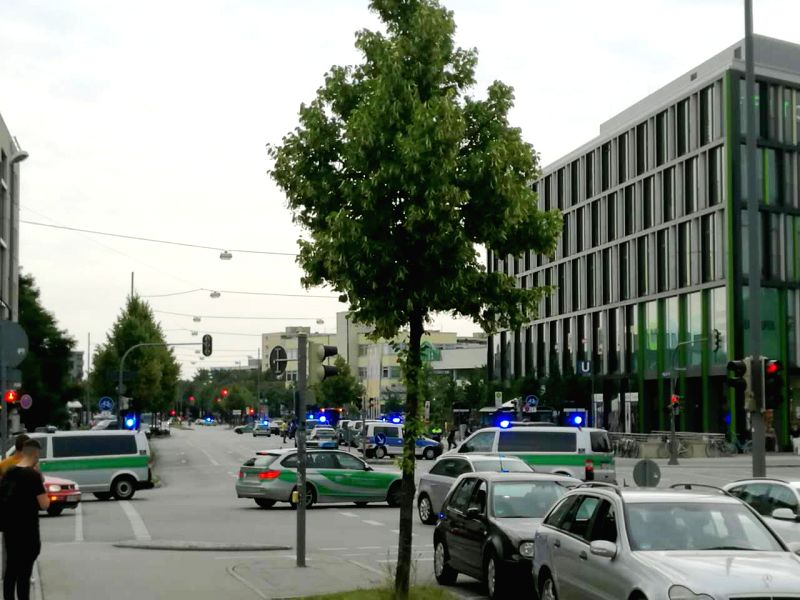 MUNICH, July 22, 2016 - Photo taken by a mobile device shows police vehicles near the Munich's shopping mall where a shootout took place in Munich, Germany, on July 22, 2016. The number of the people ...