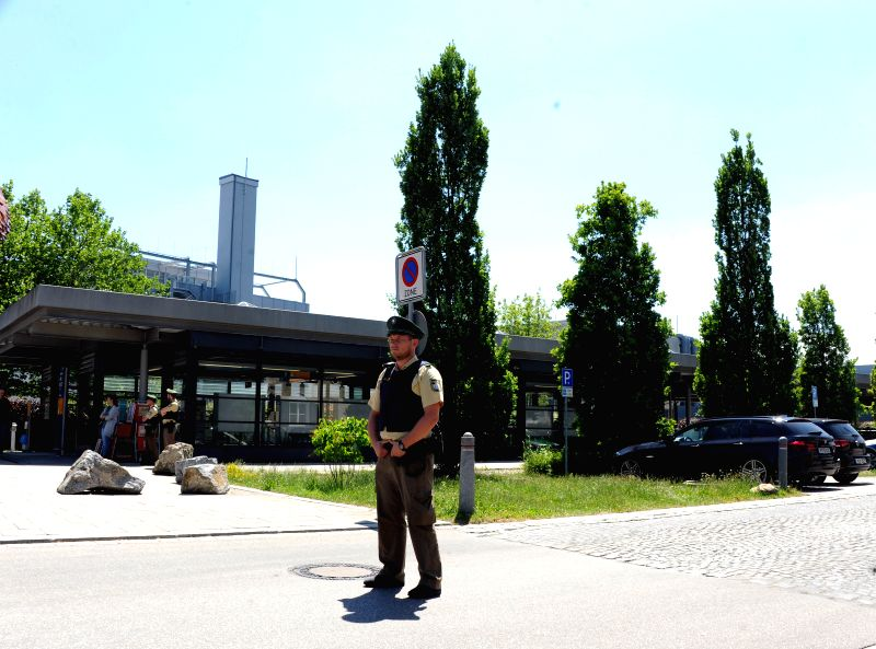 MUNICH, June 13, 2017 - A police officer stands guard near the entrance of the subway station in Munich, Germany on June 13, 2017. Police in Germany's Munich City said that several people, including ...