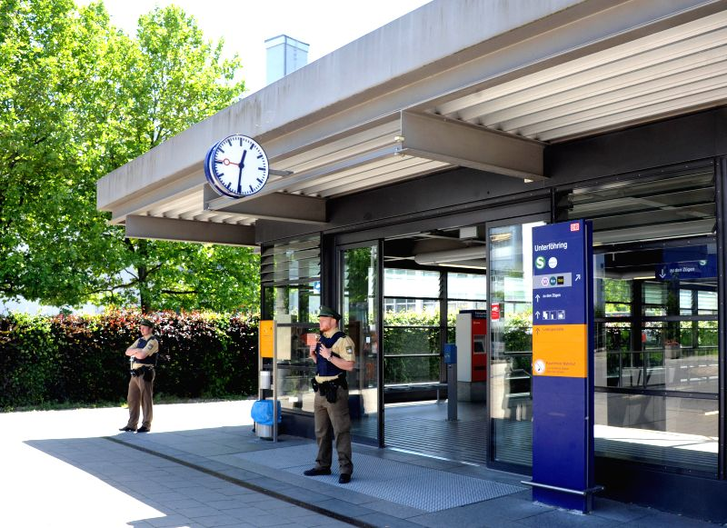 MUNICH, June 13, 2017 - Police officers stand guard at the entrance of the subway station in Munich, Germany on June 13, 2017. Police in Germany's Munich City said that several people, including a ...