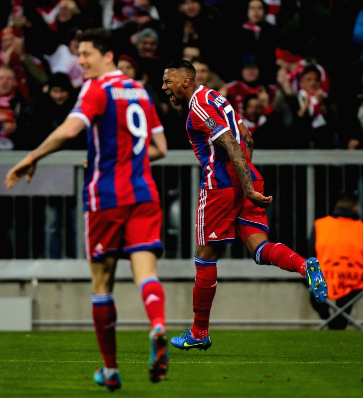 Bayern Munich's Jerome Boateng (R) celebrates scoring during the UEFA Champions League Round of 16 second leg match against Shakhtar Donetsk in Munich, Germany, on ...