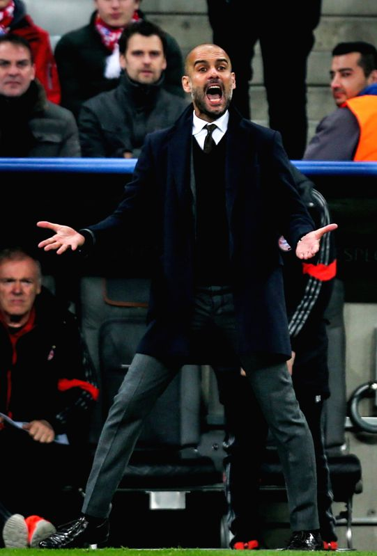 Bayern Munich's head coach Josep Guardiola reacts during the UEFA Champions League Round of 16 second leg match against Shakhtar Donetsk in Munich, Germany, on ...