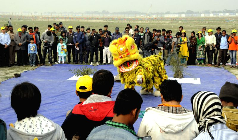 Local people watch lion dance during the national kite festival at the bank of Padma River in Munshiganj district, some 37 km from capital Dhaka, Bangladesh, ...