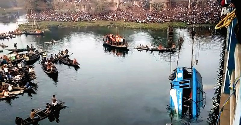 : Murshidabad: The bus that fell off the Nalini Buske bridge into the Gobra canal in Balirghat area being fished out on Jan 29, 2018. Four persons were killed and several are missing in West ...