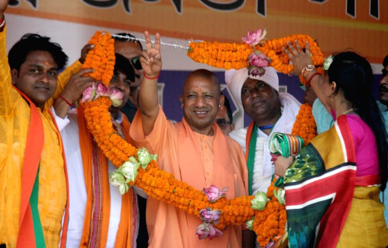Murshidabad: Uttar Pradesh Chief Minister Yogi Adityanath being welcomed by BJP workers at a public rally in West Bengal's Murshidabad, on April 22, 2019. (Photo: Indrajit Roy/IANS)