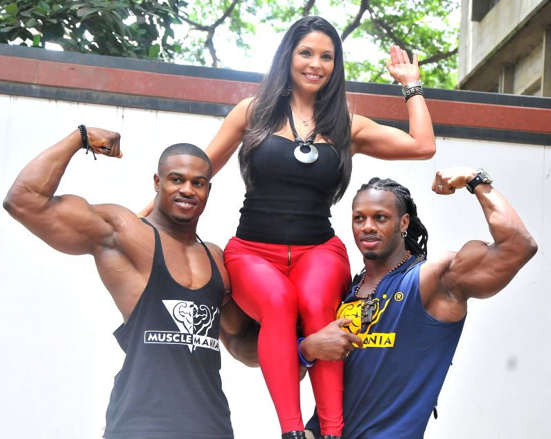 Muscle mania World Pro Champion-2013 Ulisses Jr, Musclemania Europe Champion-2013 Simeon Panda  and Model America Champion Jessica Vasqeuz during a press conference in Bangalore on May 9, 2014. - America Champion Jessica Vasqeuz