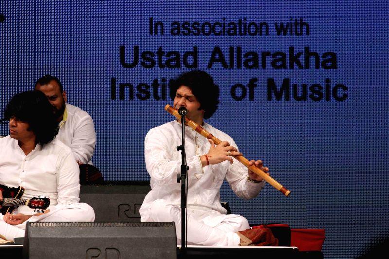 Music composer and flautist Rakesh Chaurasia performs during the concert organised by Ustad Allarakha Institute of Music to mark the death anniversary of tabla legendary Ustad Allarakha Khan and ... - Ustad Allarakha Khan