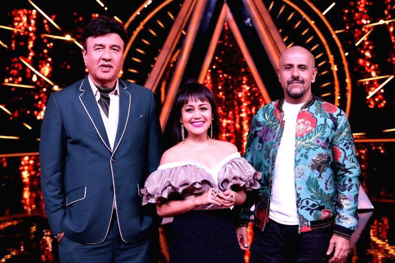 """Music composer Anu Malik, Singer Neha Kakkar and Singer-composer Vishal Dadlan on the sets of singing reality show  """"Indian Idol 10"""" in Mumbai on July 24, 2018. - Malik"""