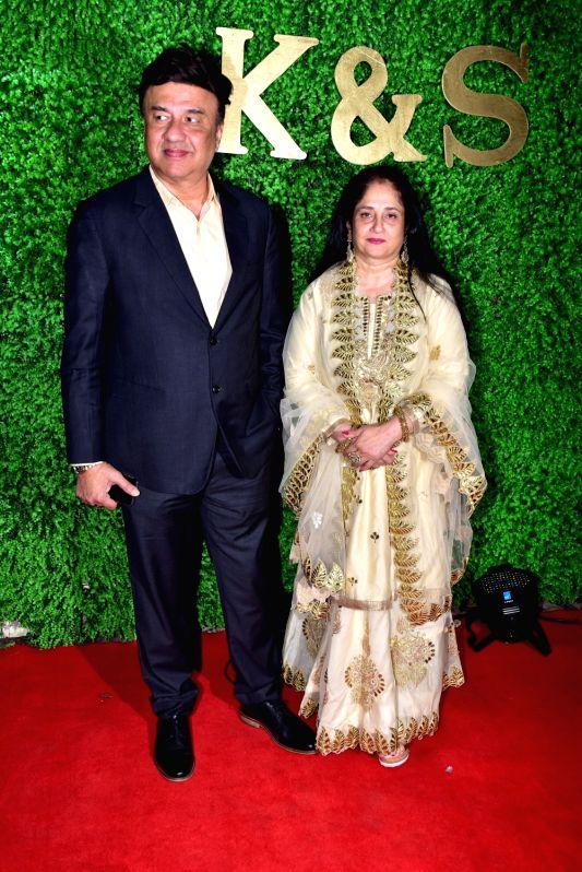 Music composer Anu Malik with his wife Anju Anu Malik at the wedding reception of lyricist Sameer Anjaan's daughter Suchita in Mumbai, on Jan 22, 2019. - Malik