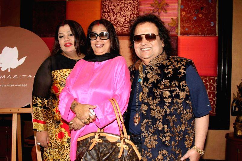 Music composer Bappi Lahiri along with his wife Chitrani Lahiri and daughter Rema Lahiri during the showcase of Padmasitaa Vivaha exhibition in Mumbai, on November 20, 2015.