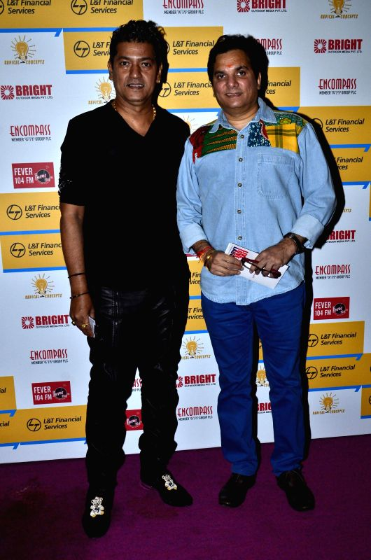 Music composers Aadesh Shrivastava and Lalit Pandit during Shaan`s musical concert organised at NCPA Ground in Mumbai, on Aug. 23, 2014.