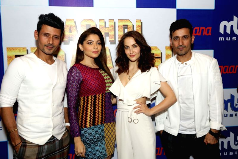 "Music director duo Manmeet and Harmeet Singh , singer Kanika Kapoor and actress Elli AvrRam at the song launch of ""Nachdi Firangi"" in New Delhi on June 20, 2018. - Elli Avr, Harmeet Singh and Kanika Kapoor"