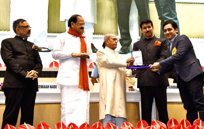 "Music Director Tanuj Tiku, who won Best Music award for ""Leeches"", being felicitated by President Pranab Mukherjee with Rajat Kamal Award at the 64th National Film Awards ... - M. Venkaiah Naidu, Pranab Mukherjee and Rajyavardhan Singh Rathore"