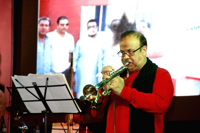 Musician Kishore Sodha with his trumpet during `Pachattare Pancham- Yaadon Ki Baraat`a musical event organised on the 75th birth anniversary of the legendary music composer R.D.Burman by Melody ...