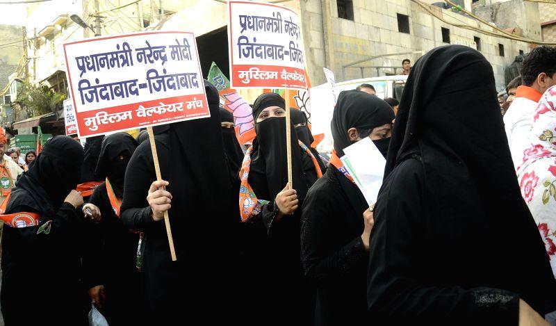 Muslim women campaign for BJP ahead of Delhi MCD Polls in New Delhi on April 20, 2017.