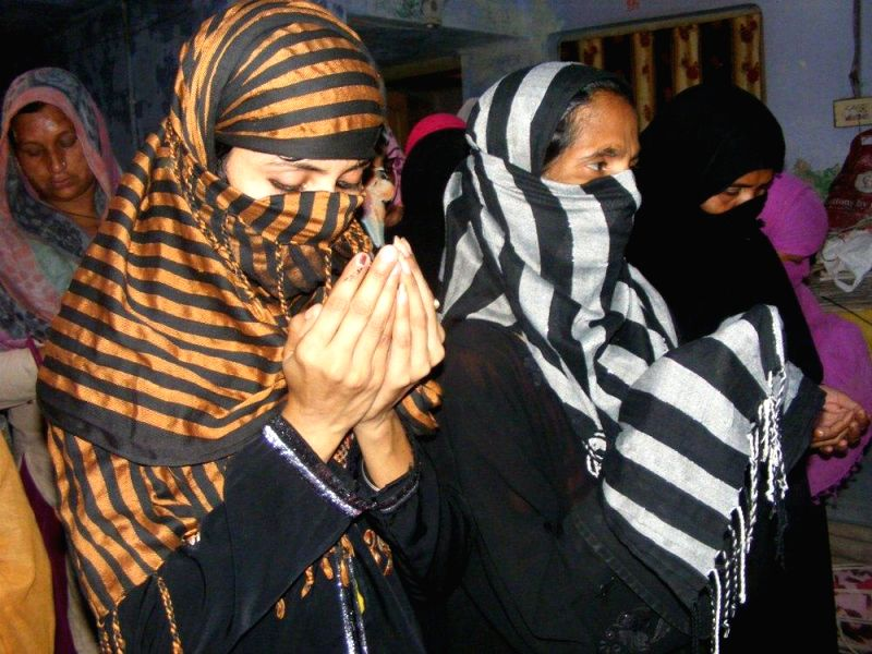Muslim women pray for the victory of BJP Prime Ministerial candidate and Gujarat Chief Minister Narendra Modi in Varanasi on May 16, 2014.