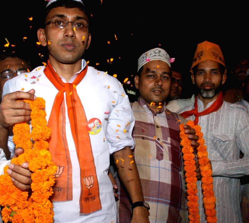 Muslim youths wait for BJP Prime Ministerial candidate and Gujarat Chief Minister Narendra Modi to welcome him in Varanasi on May 8, 2014.
