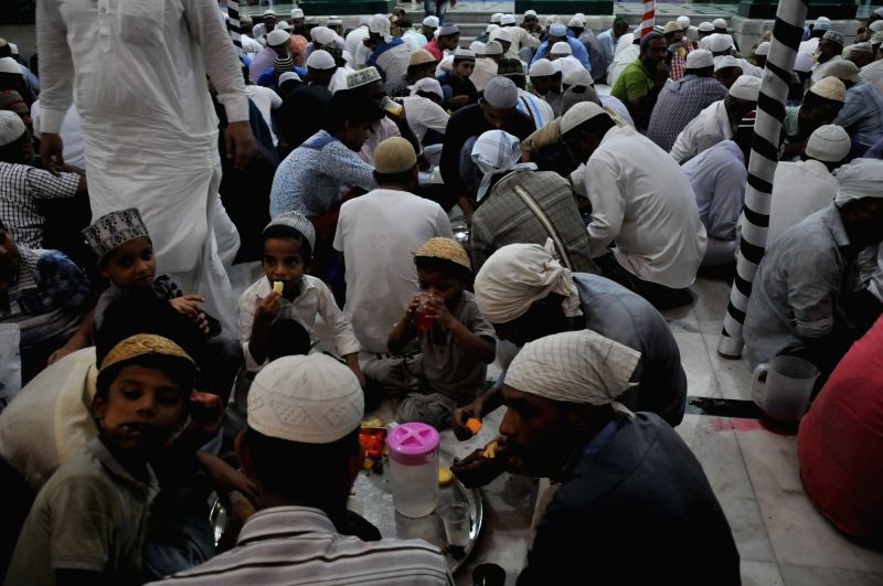 Muslims break their fast during Ramadan at Iqbal Maidan in Mumbai on May 29, 2017.