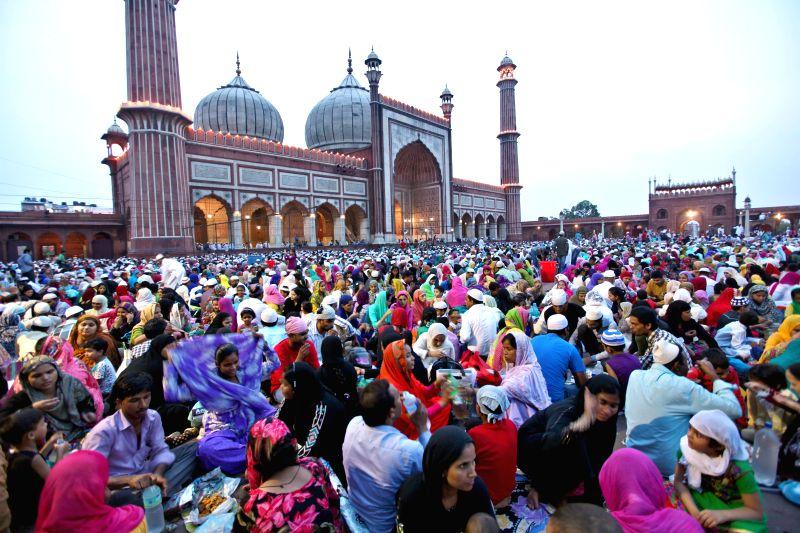 Muslims break their fast in front of Jama Masjid in New Delhi on July 27, 2014.