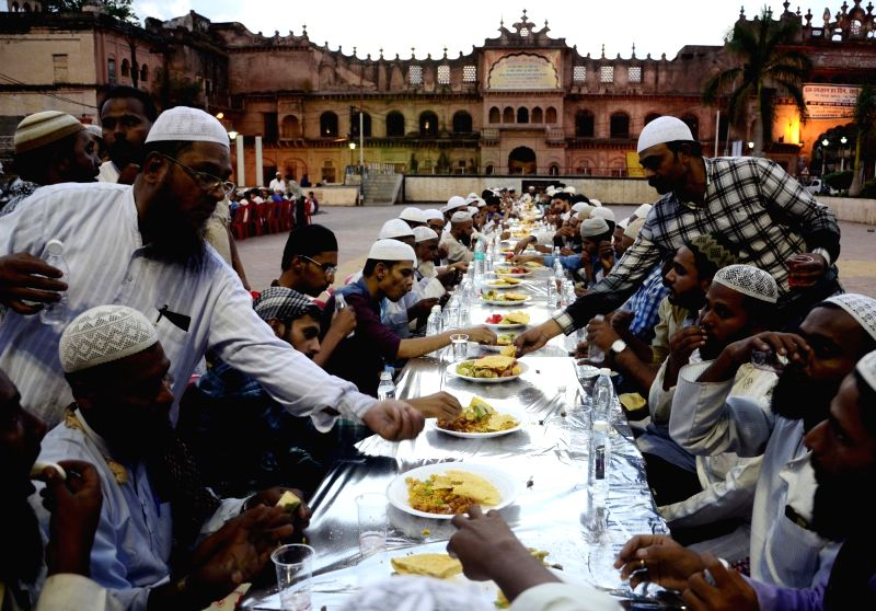 Muslims break their fast on the first day of Ramadan at Iqbal Maidan in Bhopal on May 28, 2017.