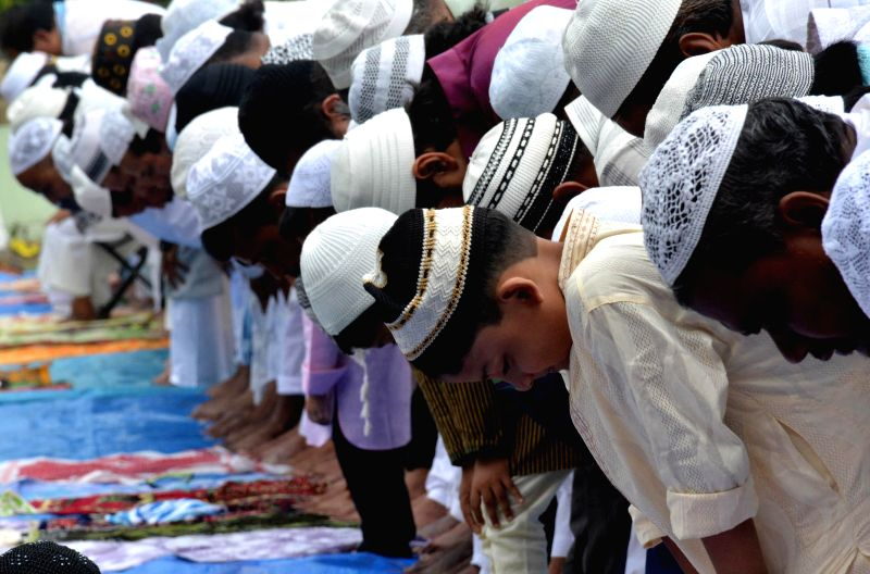 Muslims offer namaz on the occasion of Eid ul-Fitr celebrations at Iddgah field in Guwahati on Tuesday  29th July 2014.