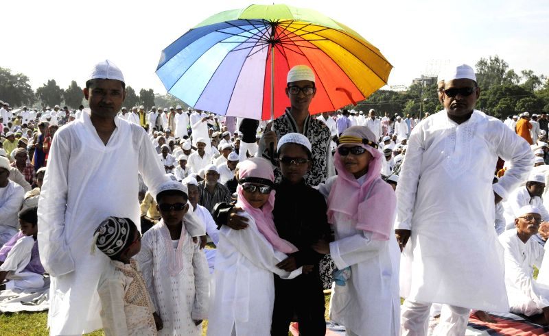 Muslims offer prayers on occasion of Eid-ul-Fitr in Patna on July 29, 2014.
