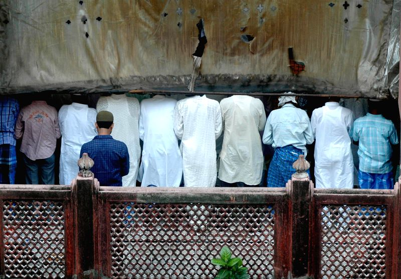 Muslims offer prayers on occassion of Eid-ul-Fitr at the Nakhoda Mosque in Kolkata on July 29, 2014.