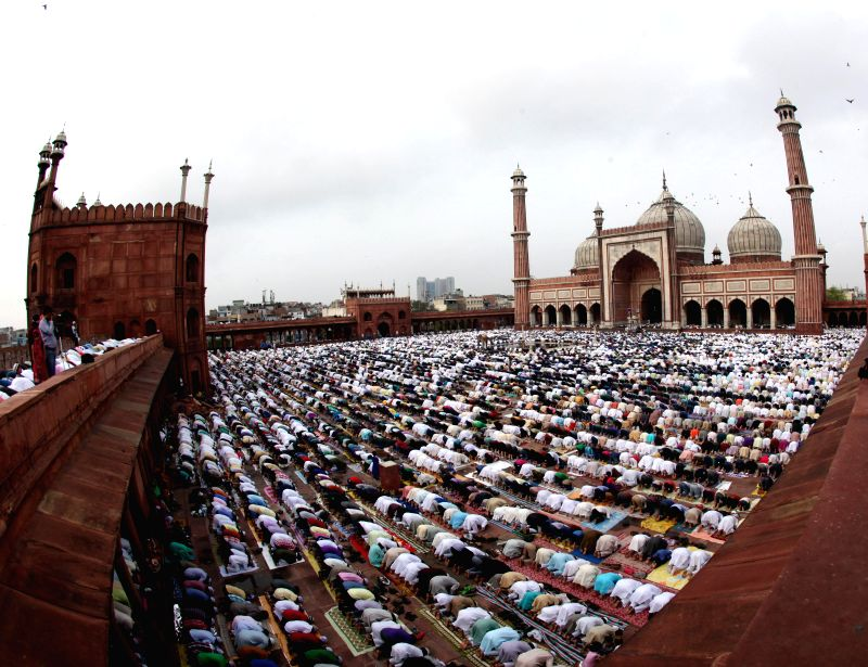 Muslims offer prayers on occassion of Eid-ul-Fitr at the Jama Masjid in Delhi on July 29, 2014.