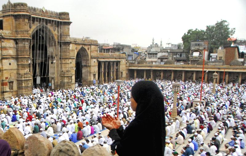 Muslims offer prayers on the occasion of Eid ul-Fitr at a mosque in Ahmedabad on July 29, 2014.