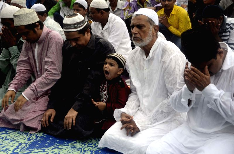 Muslims offering prayers on ocassion of Eid-ul-Fitr in Mumbai on July 29, 2014.