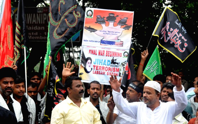 Muslims participate in a rally to condemn recent militant attacks in Iraq, in Kolkata on June 20, 2014.
