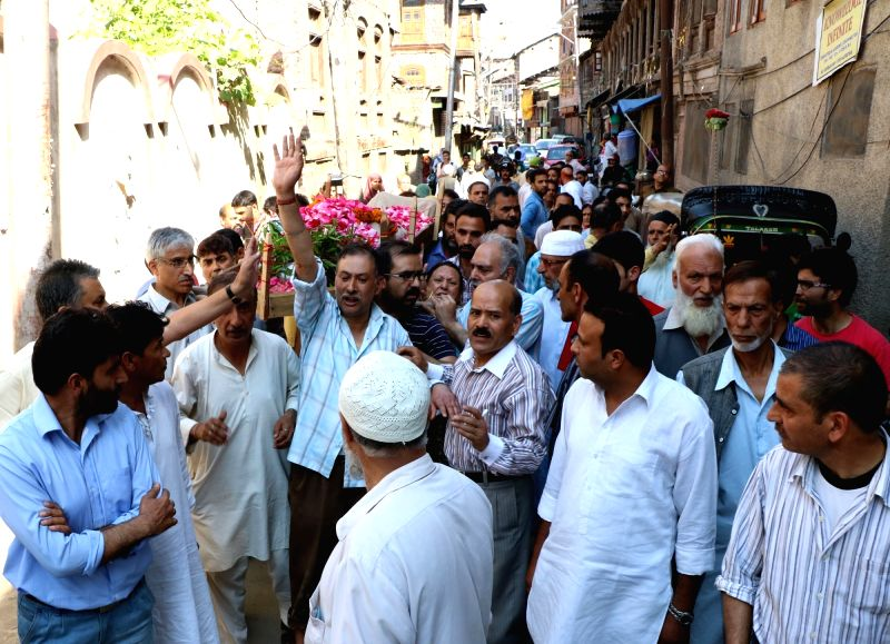 Muslims participate in the funeral of a Hindu woman in Srinagar on May 18, 2016.
