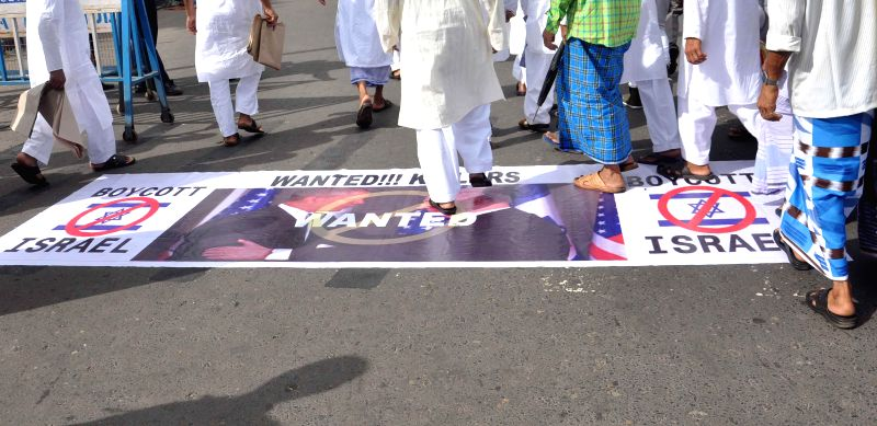 Muslims protest against Israel's offensive in Gaza during Eid-ul-Fitr prayers at the Red Road in Kolkata on July 29, 2014.