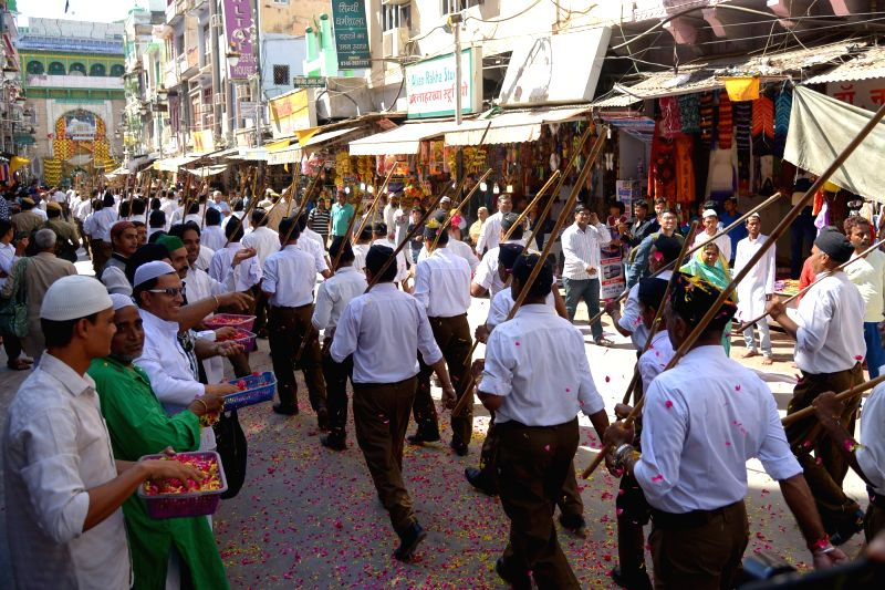 Muslims shower flower petals on Rashtriya Swayamsevak Sangh (RSS) volunteers participating in a route march organised on RSS Foundation Day in Ajmer on Sept 30, 2017.