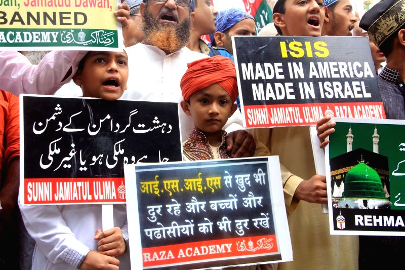 Muslims stage a demonstration against ISIS in Mumbai on July 22, 2016.