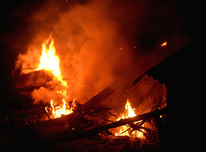Torched houses in violence hit Ajitpur Bahilwara village of Bihar's Muzaffarpur district a day after three people were burnt to death and 10 were injured when a mob torched over three ...