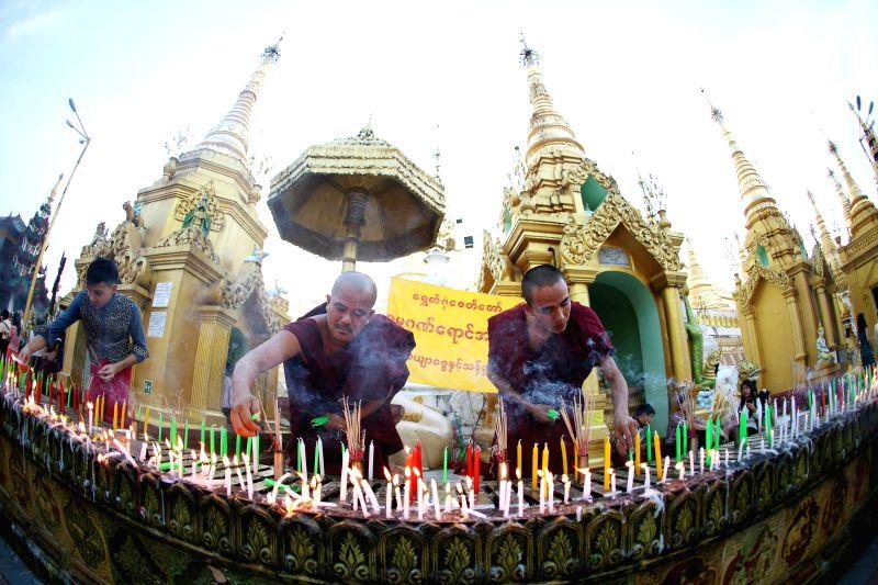 Myanmar Buddhist monks light candles on Myanmar's traditional Thadingyut lantern festival at the Shwedagon Pagoda in Yangon, Myanmar, on Oct. 28, 2015. The ...