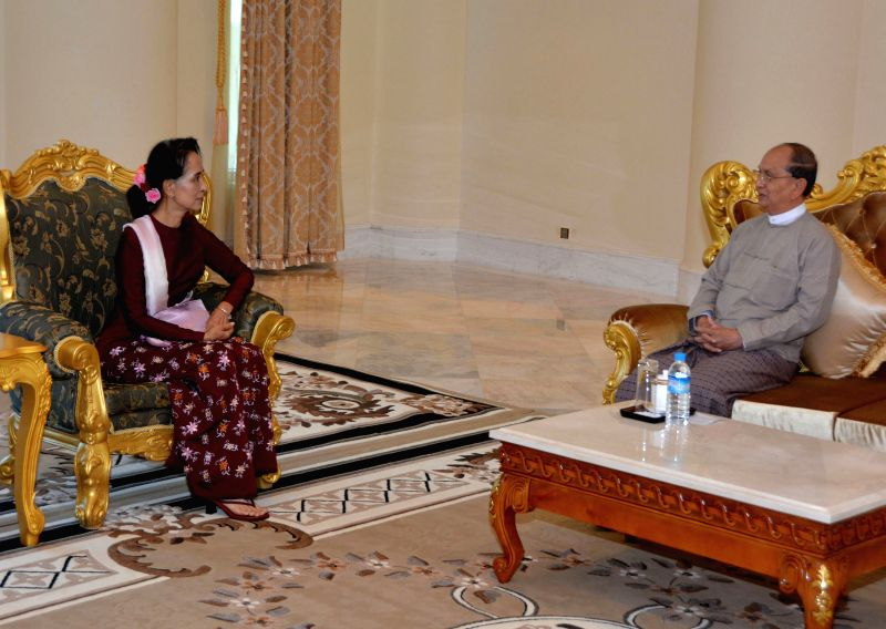 Myanmar President U Thein Sein (R) meets with Aung San Suu Kyi, chairperson of the election-winning opposition National League for Democracy, at the Presidential ...