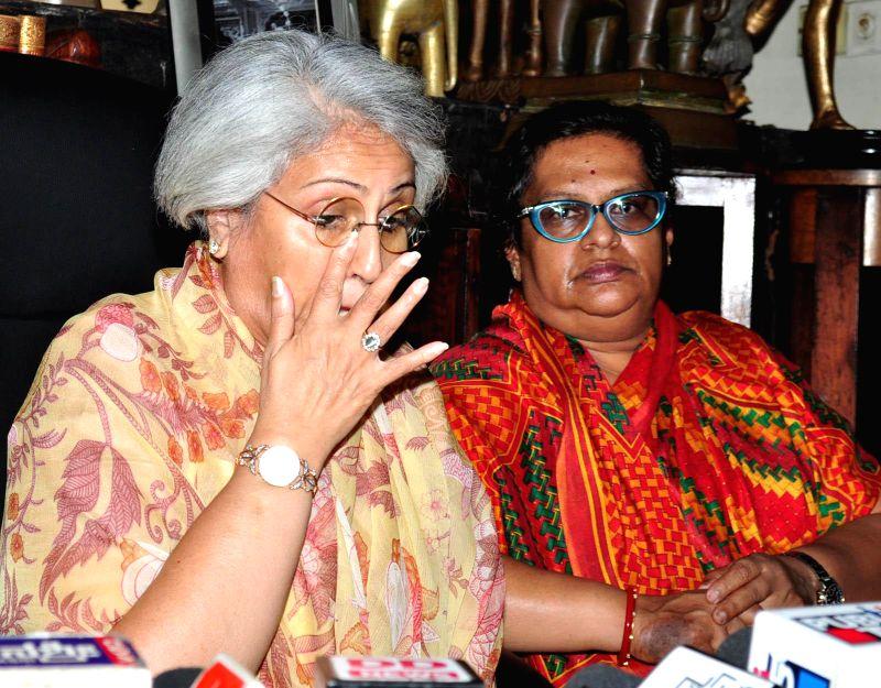 Pramoda Devi Wadiyar, wife of Srikanta Datta Narasimharaja Wadiyar with Gopal Raj Urs - the successor to Srikanta Datta Narasimharaja Wadiyar at Mysore Palace on Feb 12, 2015. (File Photo: ...