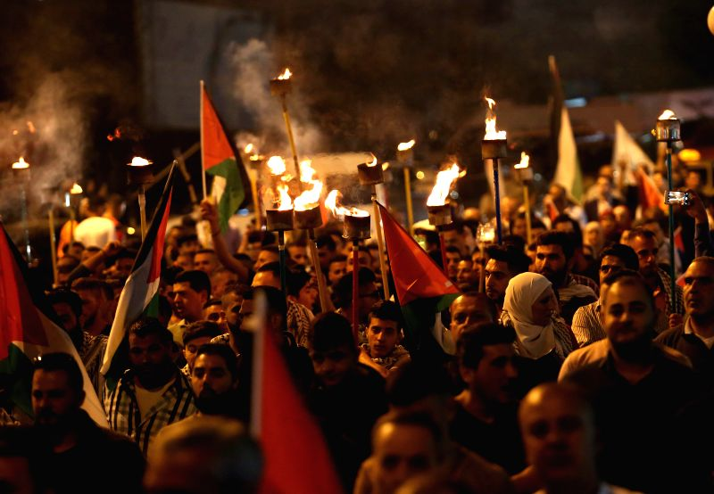 NABLUS, April 29, 2017 - Palestinians hold torches during a march in support of Palestinian prisoners on hunger strike in Israeli jails, in the West Bank city of Nablus, on April 29, 2017. Hundreds ...