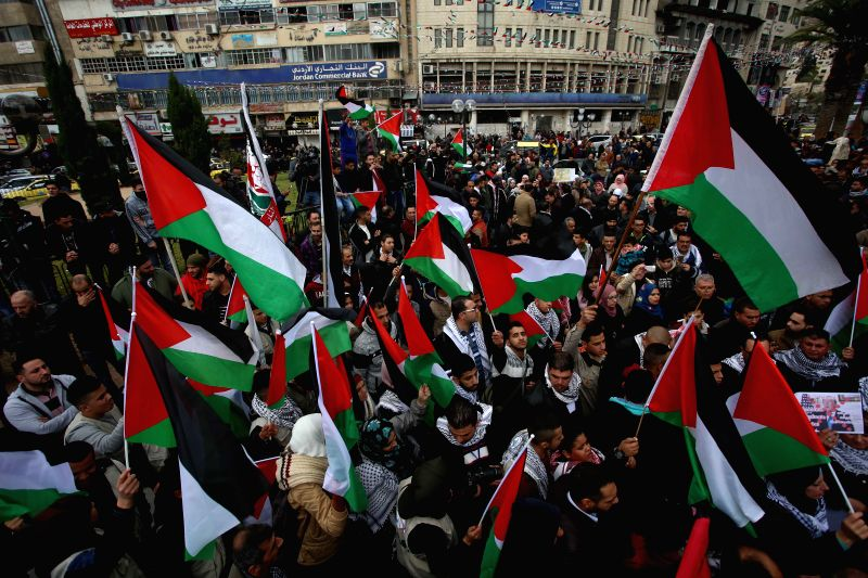 NABLUS, Dec. 7, 2017 - Palestinians hold national flags as they take part in a protest against the U.S. decision to recognize Jerusalem as Israel's capital, in the West Bank city of Nablus, on Dec. ...